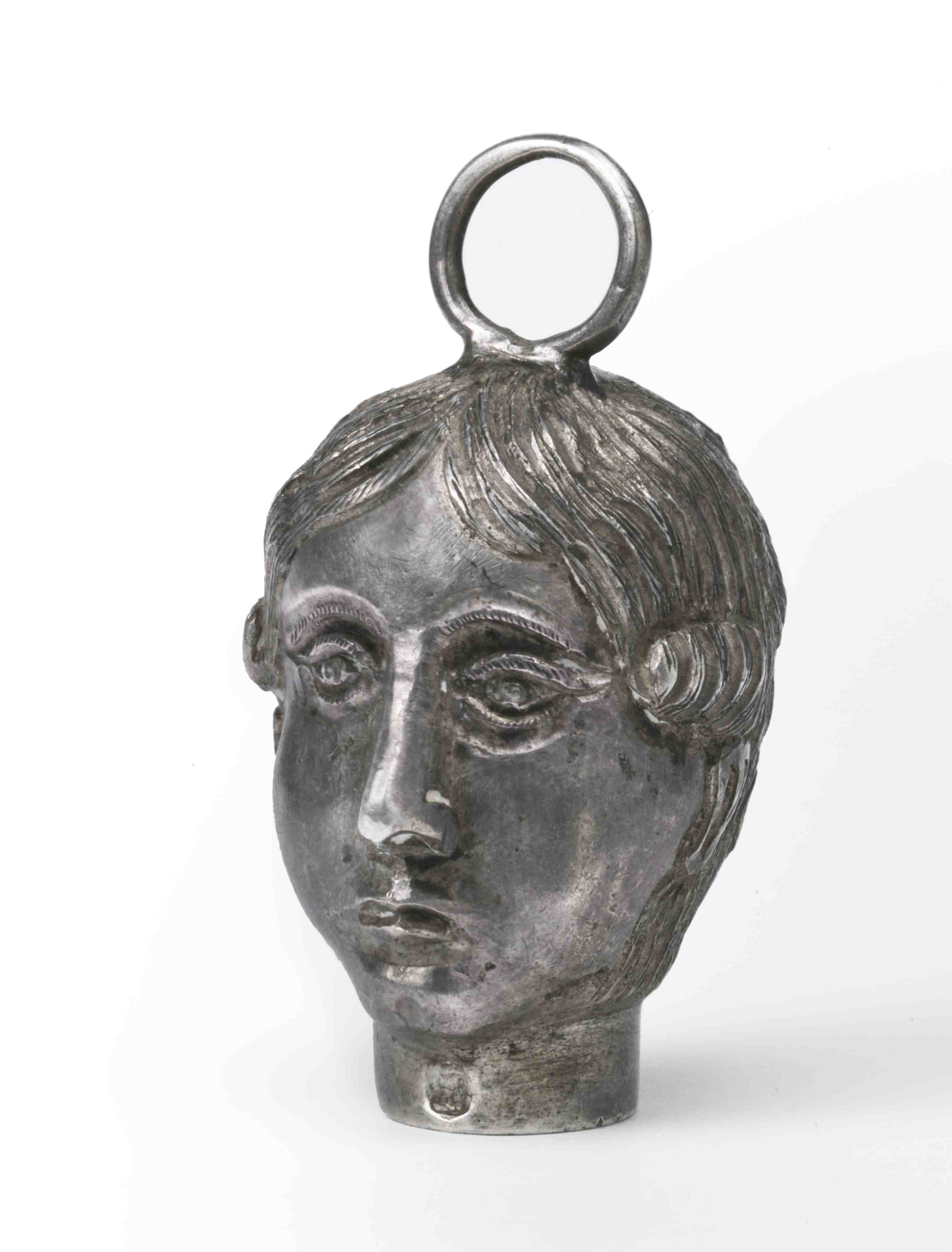 Ex-voto in the form of female head